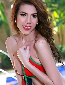 Asian Liliana undressing next to the pool
