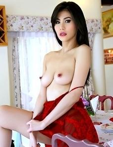 Sexy Asian Natalie Wang fucks herself with a dildo