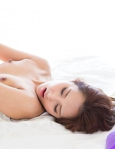 Uika Hoshikawa finally takes off her purple panties to reveal a trimmed pussy