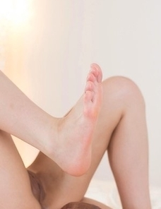 Ena Nishino proudly displaying her cum-covered soles in a footjob aftermath