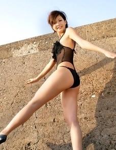 Rina Nagasaki in see through lingerie shows legs on rocks