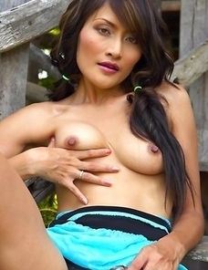 Don't miss the fantastic Bella Yong as she sits in the woods and gazes at the camera. This babe has such an exotic look as she exposes her hot ti