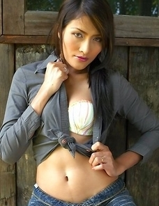 Bella Yong is a sexy babe that has on a dark shirt and shorts. She begins taking it off as she gives a sexy look to the camera.