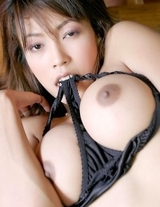 Chan Ching Ming walks around a room and she is wearing sexy black lingerie.