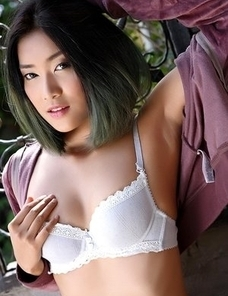 Asian cute Asian Apple takes off her shorts and strokes herself between her legs