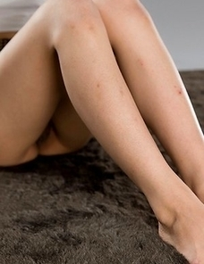 Karina Oshima posing in her sexy skirt before going down on the floor to masturbate