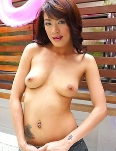 Venus Willa has fun as she takes off her top and gazes at the camera. Her bra is removed and her tits are so amazing.