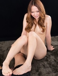 Rena Matsumoto carefully jerking that thick dick with her perfect-looking feet