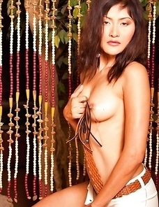Find Bella Yong as she walks through the curtain and feels on her wonderful tits.