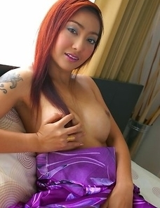 Iko Yeung begins getting on the freaky side as she drops her top. She lets her nipple peak out and it is dark and hard.